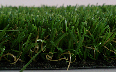24mm pile height hardwearing soft, durable, non infill monofilament grass surface. Best for lawns pathways and play areas. Artificial Grass Installers in Dorset.